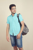 Student with a schoolbag. A guy is a student with a schoolbag on a neutral background Royalty Free Stock Image
