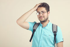 Student with a schoolbag. A guy is a student with a schoolbag on a neutral background Royalty Free Stock Photos