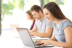 Student searching on line in a classroom stock images