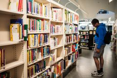 Student searcing for books in City of Tampere Main Library Metso Royalty Free Stock Image