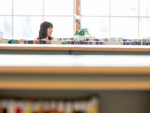 Student Selecting Book In Bookstore Royalty Free Stock Photography