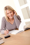 Student series - Blond girl studying home. Blond girl studying mathematics home stock images