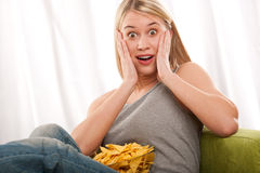 Student series - Scared in front of TV Royalty Free Stock Images