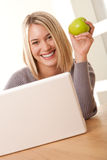 Student series - Smiling blond student working Royalty Free Stock Photos