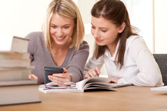 Student Series - Two Friends Writing Homework Royalty Free Stock Photos