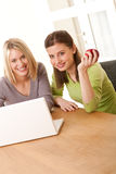 Student series - Two smiling girls watching laptop Royalty Free Stock Photos