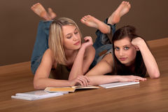 Student series - Two students lying Royalty Free Stock Photos