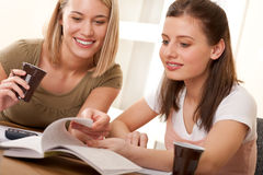 Student series - Two students studying together Royalty Free Stock Photos