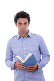 Student in shirt holding a book Royalty Free Stock Photo