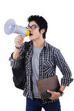 Student shouting through megaphone. College student shouting through megaphone isolated on white background Stock Image