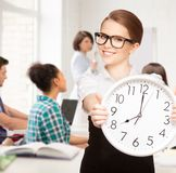 Student showing clock Stock Photo