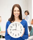 Student showing clock Royalty Free Stock Images