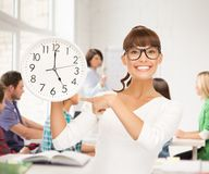 Student showing clock Royalty Free Stock Photos