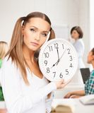 Student showing clock Royalty Free Stock Image