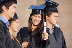 Student Showing Diploma While Standing With Stock Images