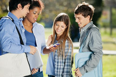 Student Showing Mobilephone To Classmates In Royalty Free Stock Images
