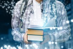 Student showing textbooks of which fly letters . royalty free stock photography