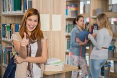 Student showing thumb up in library Royalty Free Stock Photos