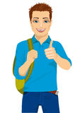 Student showing thumbs up hand sign ready to go back to college Stock Photo