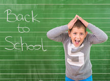 Student shows a board with the inscription: Back to School Stock Photo