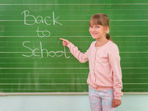 Student shows a board with the inscription: Back to School Royalty Free Stock Images