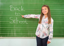 Student shows a board with the inscription: Back to School Stock Photography