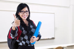 Student shows OK sign in the classroom Royalty Free Stock Images