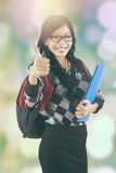 Student shows thumb up with blur background Royalty Free Stock Photo