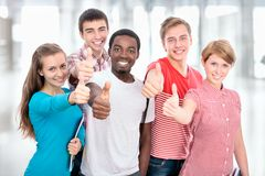 Student shows thumb up. Happy international group of student shows thumb up Royalty Free Stock Photos