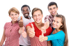 Student shows thumb up. Happy international group of student shows thumb up Royalty Free Stock Images