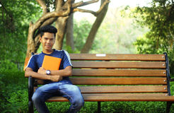 Student siting in college campus Royalty Free Stock Photos