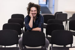 A student sits alone  in a classroom Stock Photography
