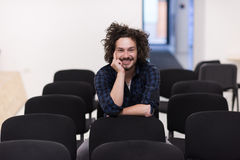 A student sits alone  in a classroom Royalty Free Stock Photography