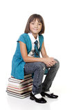 Student sits on books. Royalty Free Stock Image