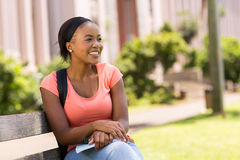 Student sitting on bench Royalty Free Stock Photography