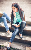 Student sitting with a book Royalty Free Stock Photography