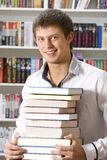 Student sitting with books Stock Photography