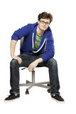 Student sitting on chair relaxed Royalty Free Stock Photos