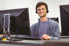 Student sitting at the computer room wearing headset. At the university Stock Image