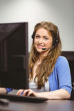 Student sitting at the computer room wearing headset Royalty Free Stock Photos