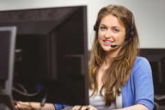 Student sitting at the computer room wearing headset Stock Images