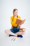 Student sitting on the floor and reading book Stock Photo