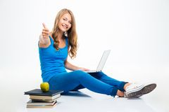 Student sitting on the floor and showing thumb up Stock Images
