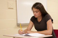 Student sitting at her desk. Royalty Free Stock Photo