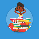 Student sitting in huge pile of books. Stock Images