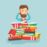 Student sitting in huge pile of books. Royalty Free Stock Photography