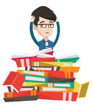 Student sitting in huge pile of books. Royalty Free Stock Image