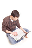 Student sitting with a laptop Stock Photos