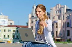 Student sitting with laptop Royalty Free Stock Photography