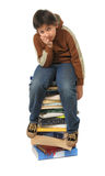 Student sitting on a pile of books. White background stock images